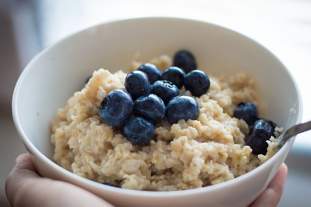 a bowl of oatmeal with blueberries for breakfast