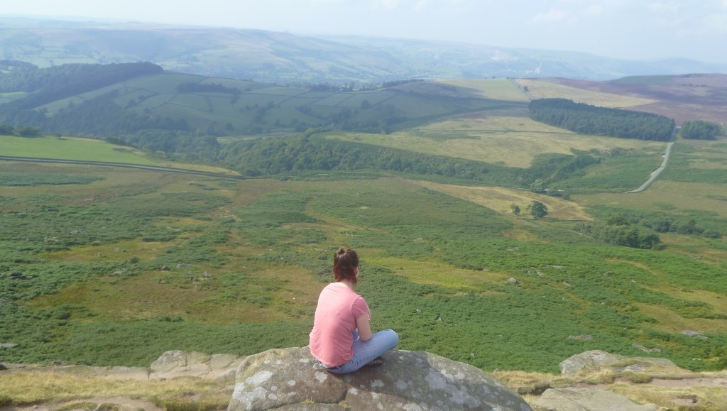 Enjoying the view from the top of Stanage Edge, Peak District