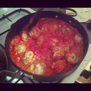 Add the peeled tomatoes to the meatballs & season