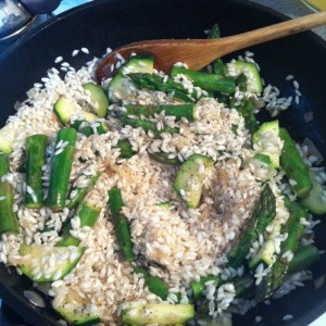 Add the risotto rice and season with pepper