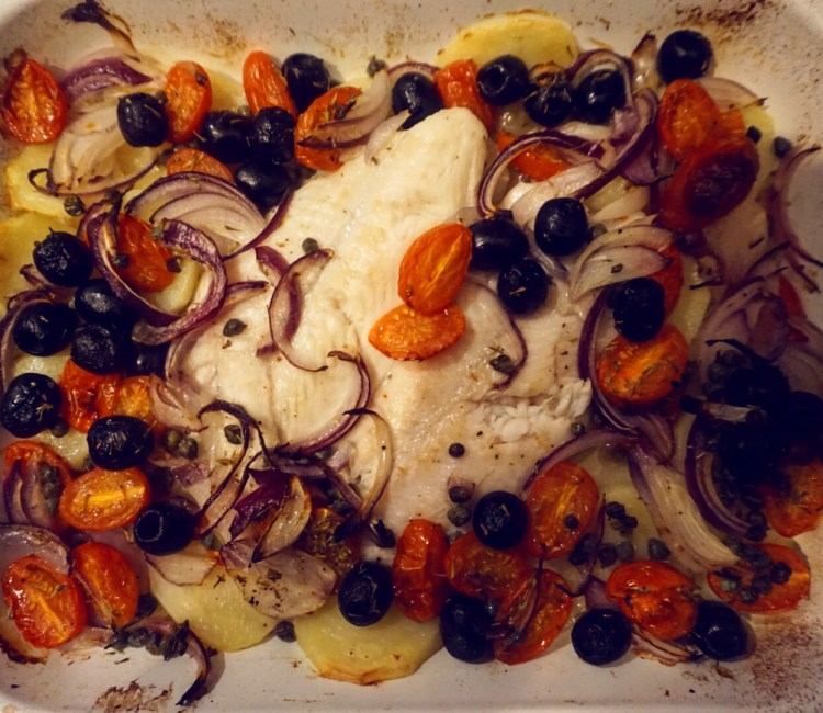 Fish with potato, tomato and olives