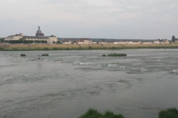 Misty evening view of Blois from across the river visiting Blois