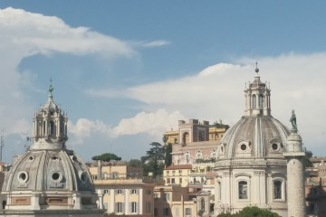 View from the top of Altare della Patria with clouds in the background.