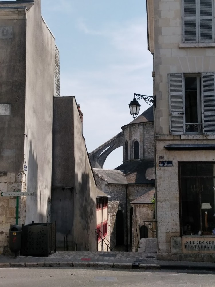 View down an alleyway of old French buildings