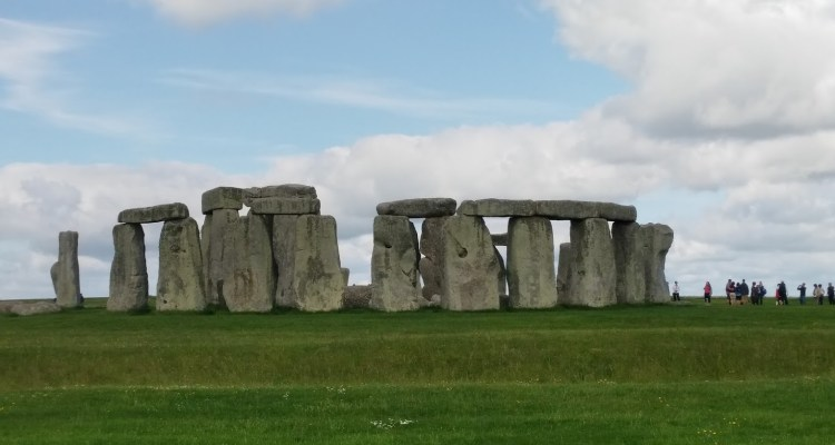 stonehenge with many clouds and a blue sky
