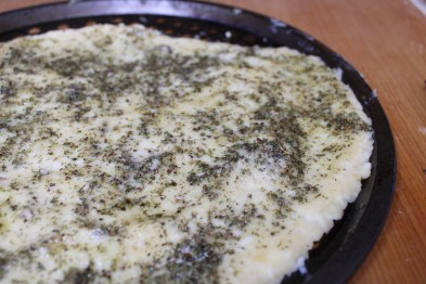 Keto pizza crust with olive oil and seasoning