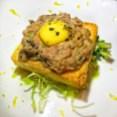 Beef Tartare with Quail Egg on Brioche Crostini