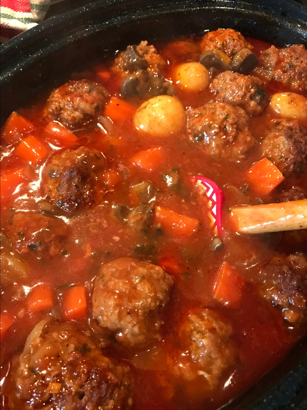 The slurry of corn starch helps thicken the gravy of the Meatball Pot Roast