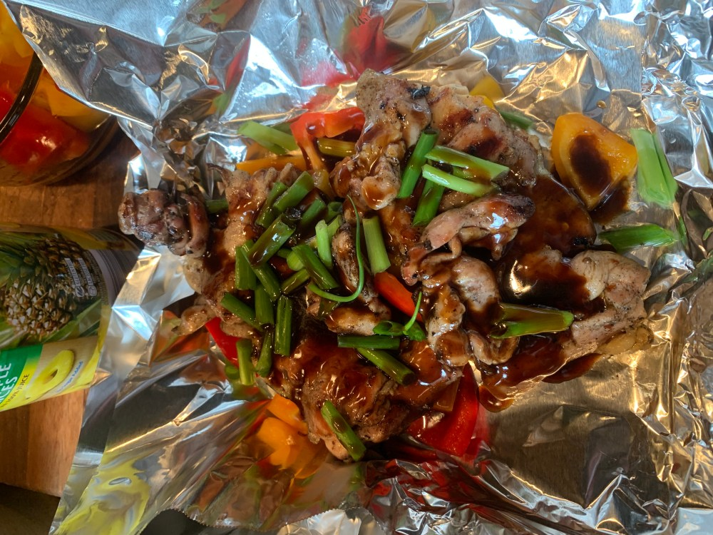 a foil packet filled with veggies and chicken