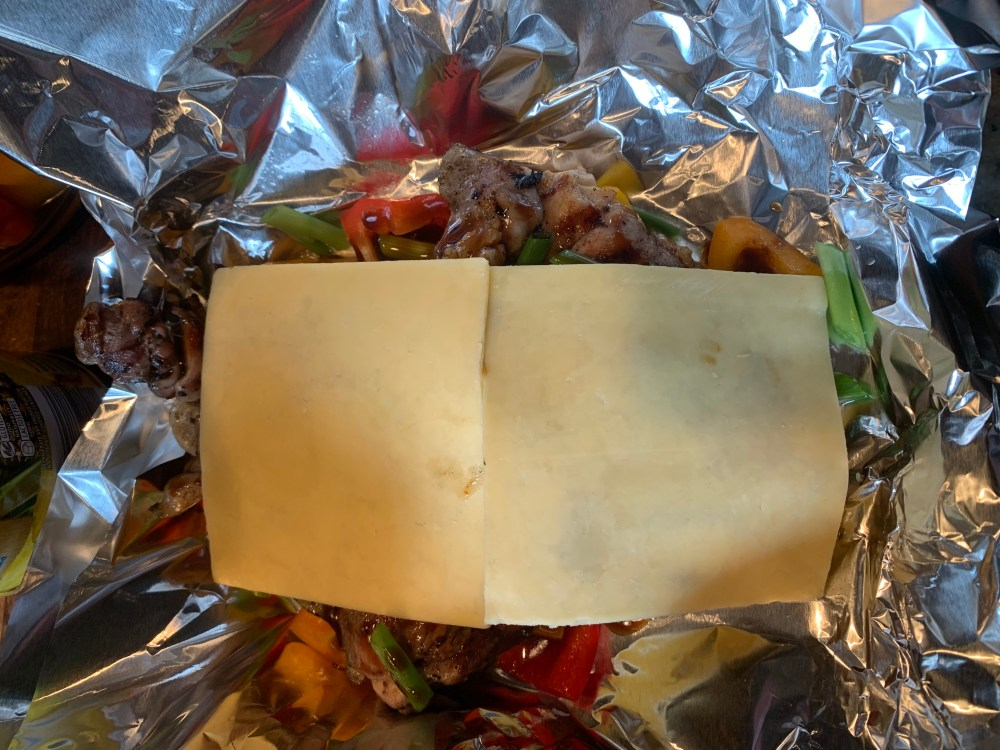 chicken foil packet topped with gouda cheese