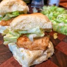 close up picture of a fried chickem slider