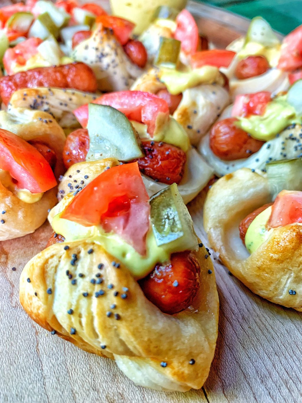 Mini hot dogs with all the toppings.