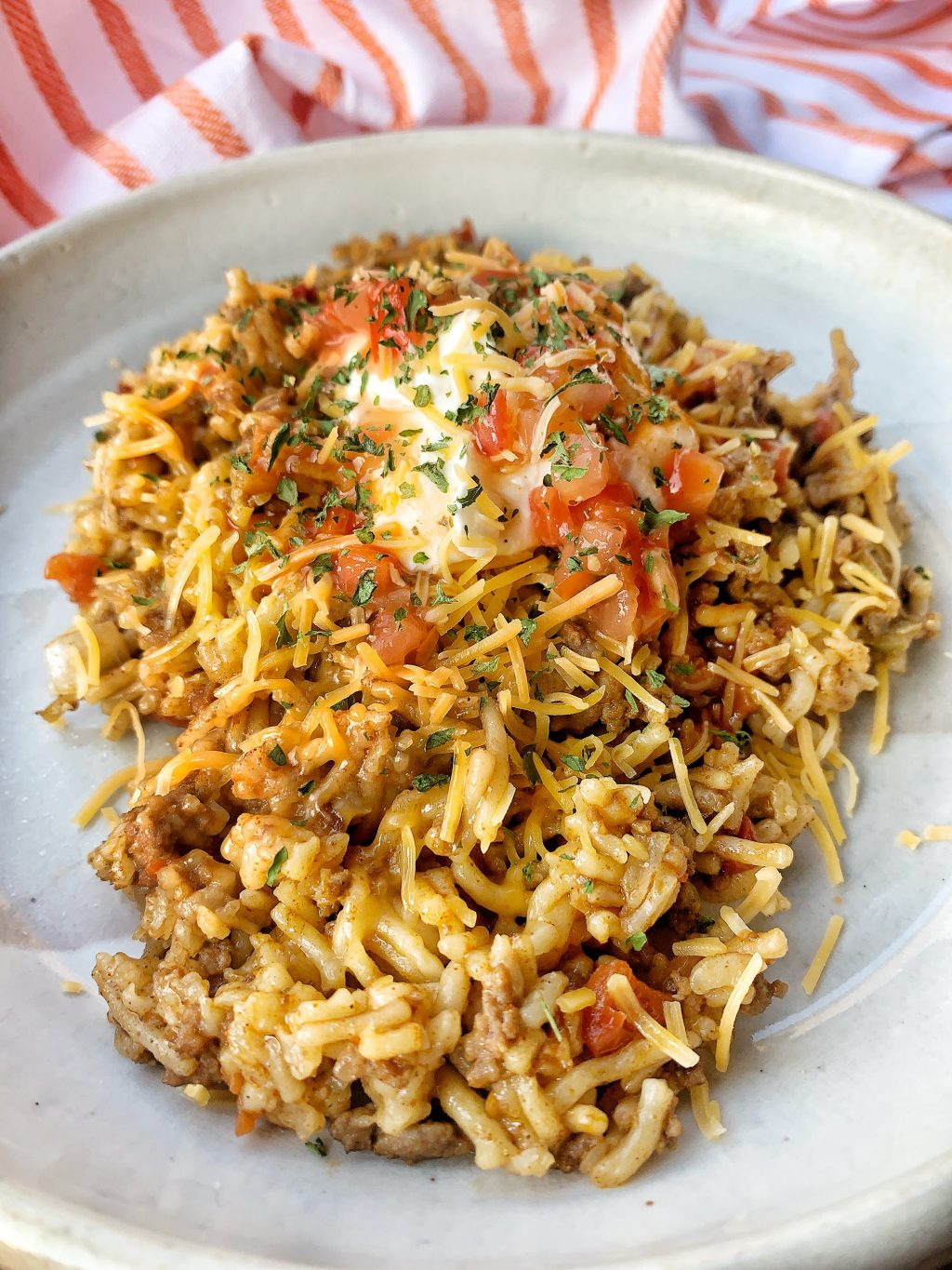 Instant Pot cooked taco rice using ground beef, taco seasoing, tomatoes and beef rice mix.