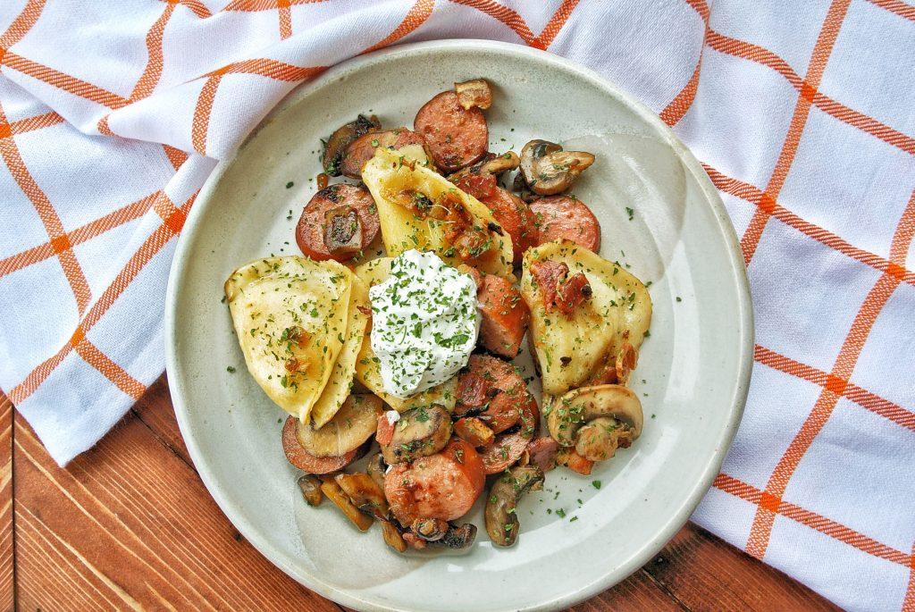 Polish sausage stir fry with pierogi, mushrooms and onions.