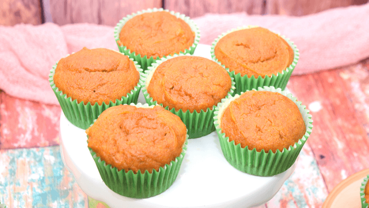 Six pumpkin cheesecake cupcakes before frosting.