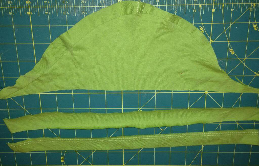 With a short sleeve, cut a long piece should be enough for two arm holes for a kid.