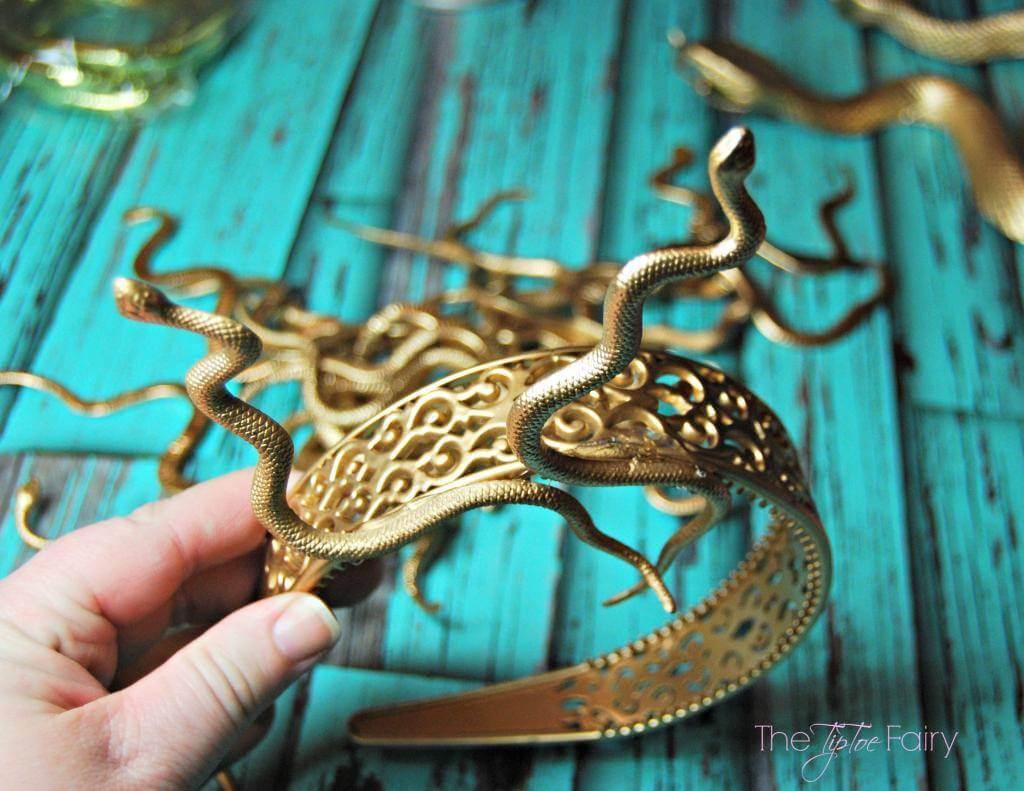 Attached snakes to medusa headband