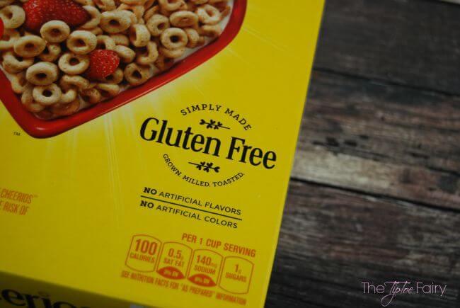 Gluten Free Cheerios Bars - peanut butter cups, chocolate and peanut butter chips, and marshmallows make these gooey treats divine! #ad #glutenfreecheerios   The TipToe Fairy