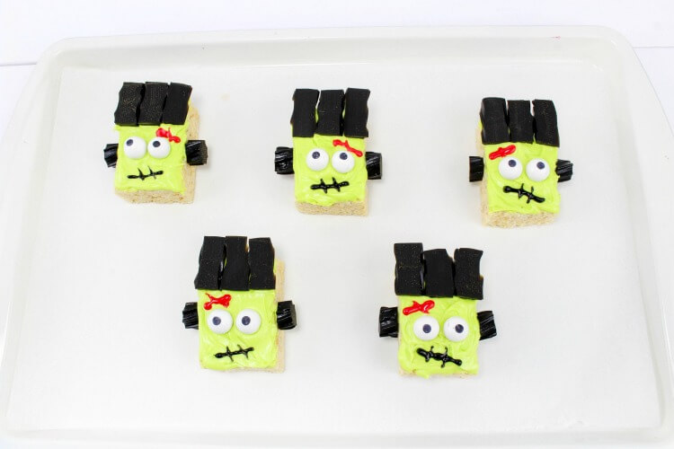 Finished Frankenstein Monster Rice Krispies Treats on a white tray.