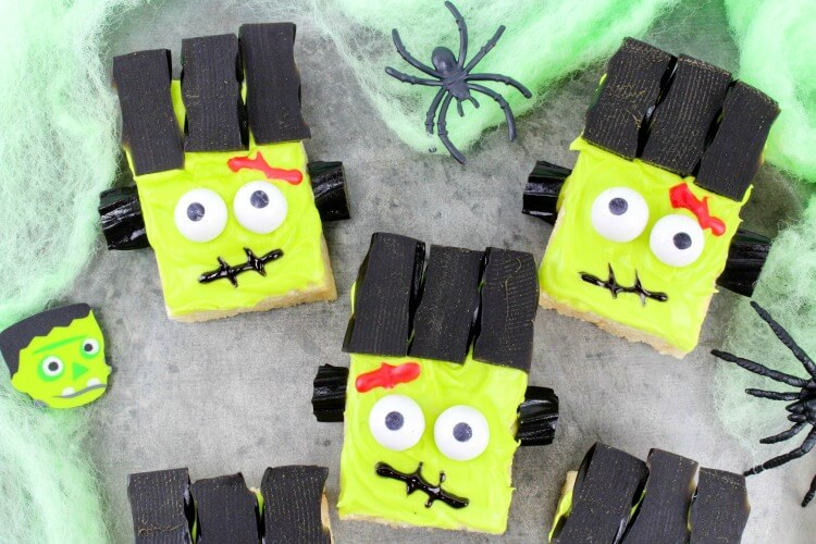 Frankenstein Monster Rice Krispies Treats on green spider webs.