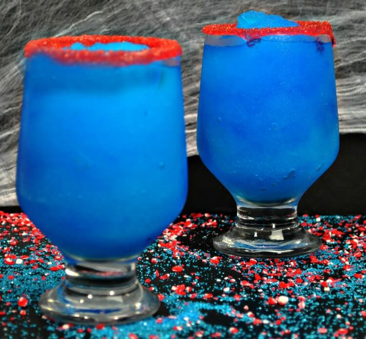 Two glasses of the blue leprechaun drink the Elixir of Fortune