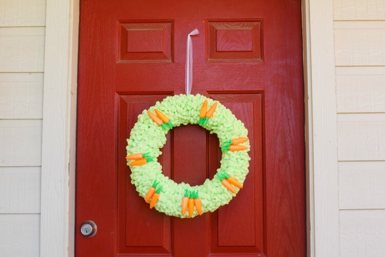 Here is the finished view of the loop yarn Easter wreath hanging from my door.