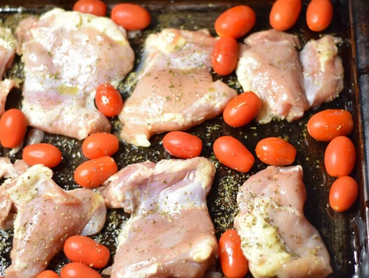 Chicken Thighs and grape tomatoes with seasoning