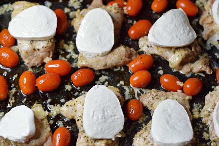adding fresh mozzarella to Chicken Thighs