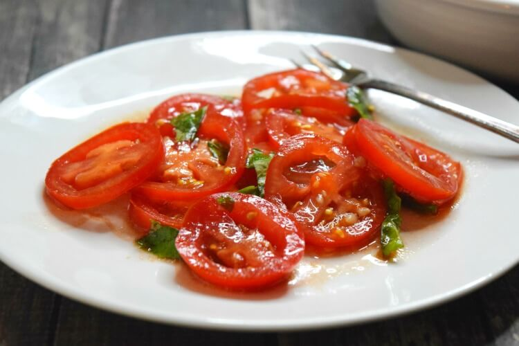 A close up of this delicious and simple tomato and basil salad.
