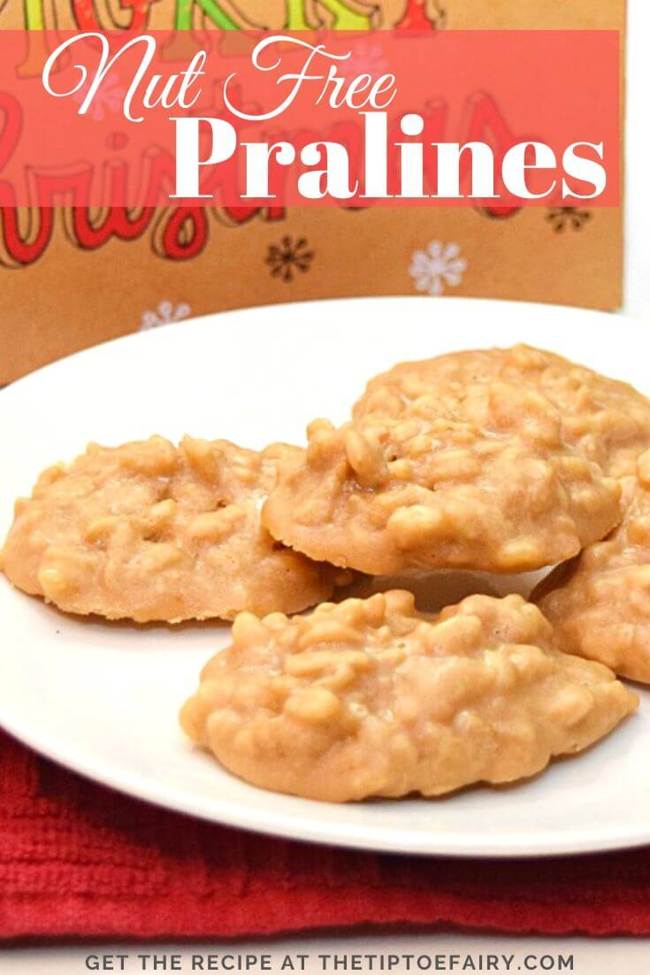 A plate full of nut free pralines in front of a Merry Christmas box.