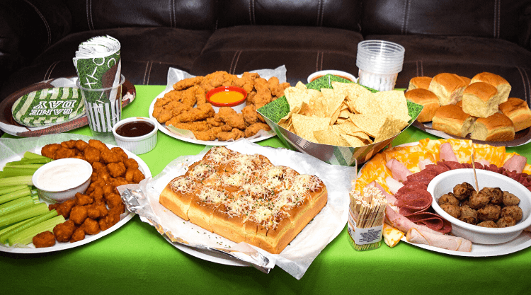 The table full of game day favorites including Tyson products and Chicken Meatball Sliders.
