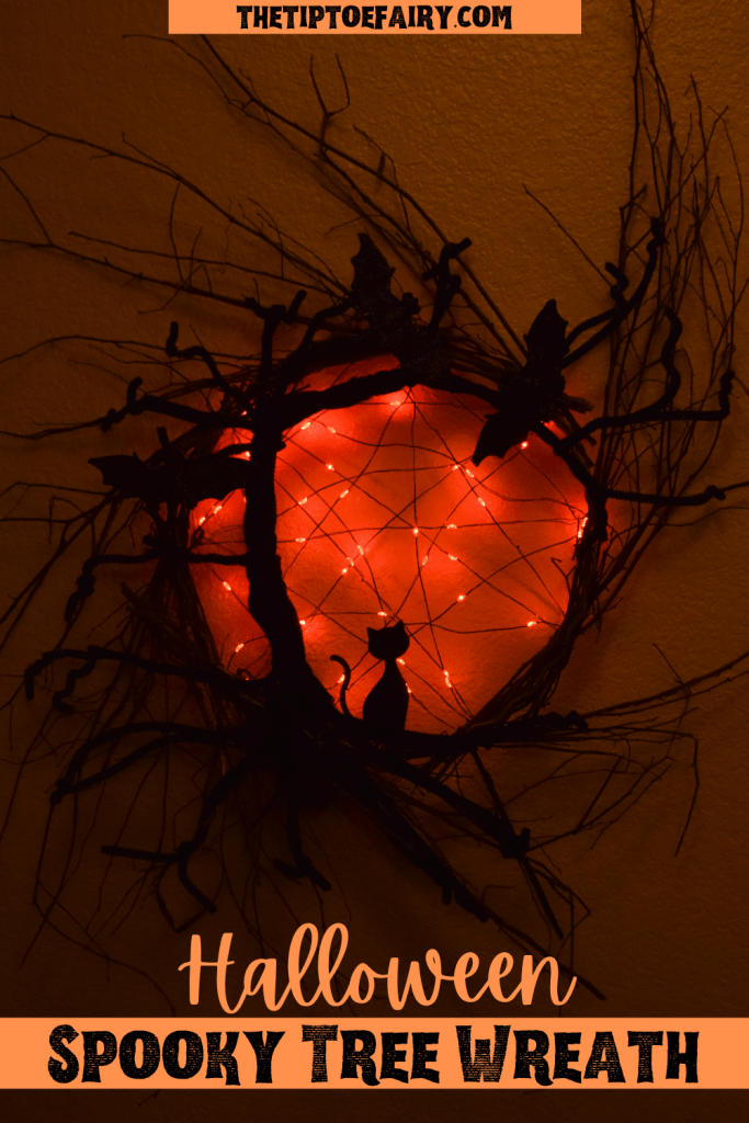 A glowing image of the Halloween Spooky Tree Wreath.