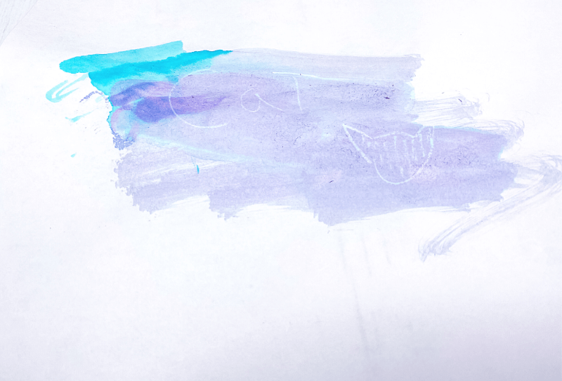 The invisible message made by white crayon is revealed with water colors
