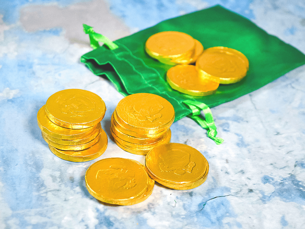 A green pouch with chocolate gold coins.