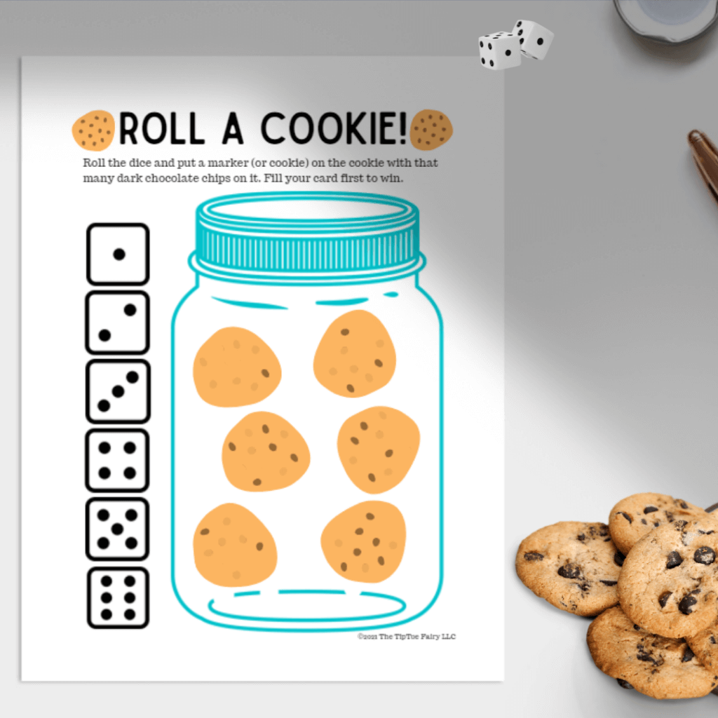 Roll A Cookie game on the table with cookies and dice.
