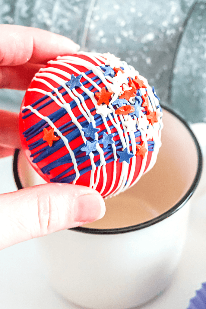 A finished patriotic hot cocoa comb about to go inside a mug.