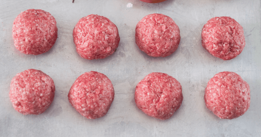 Raw meatballs on parchment paper