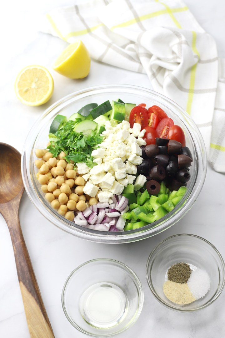 A bowl filled with ingredients for a salad.