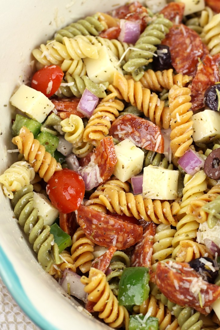And overhead look at a bowl of classic pasta salad in an aqua bowl.