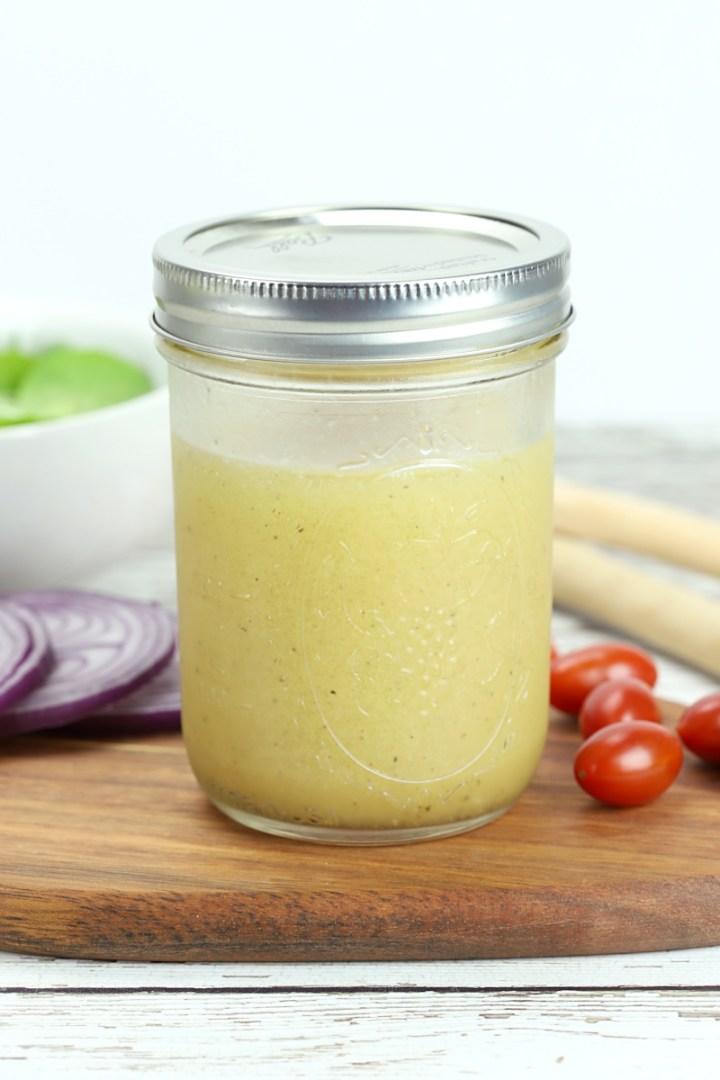 A mason jar filled with salad dressing