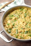 Tuscan chicken macaroni and cheese in a saute pan.