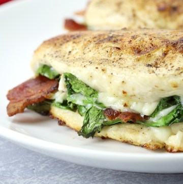 Close up of spinach, spinach, and cheese.