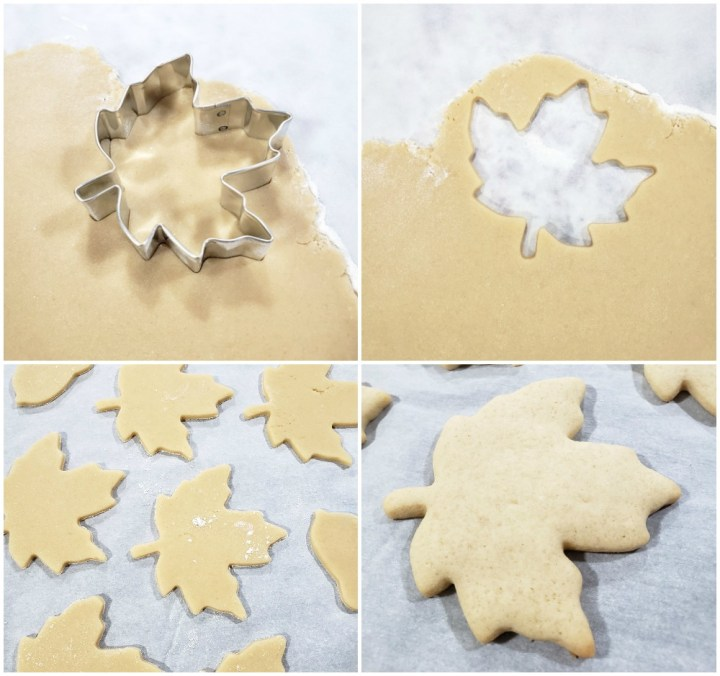 Rolling out cookie dough and cutting with a maple leaf cookie cutter.