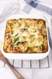 A white casserole dish filled with breakfast strata.