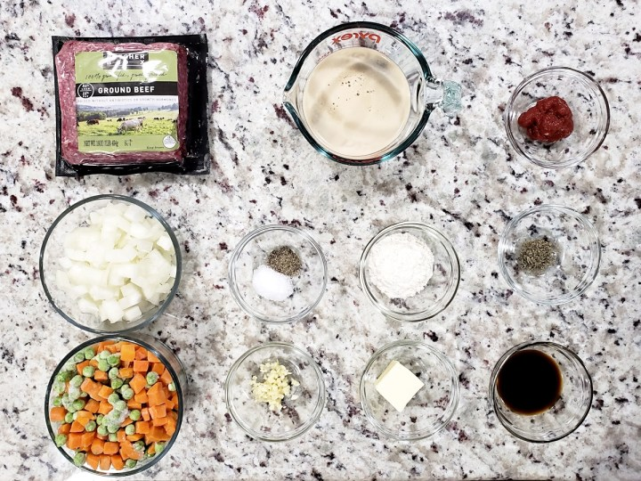 Ingredients laid out to make a beef pie filling.