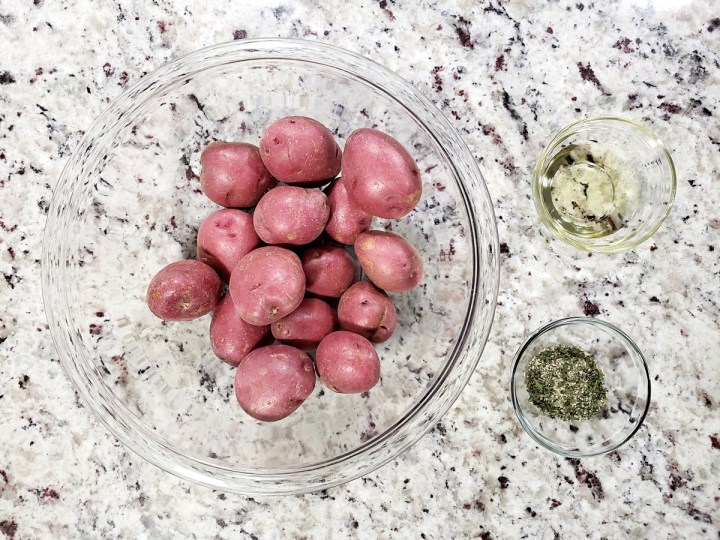 red potatoes, olive oil, and ranch seasoning in glass bowls.