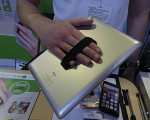 A tablet held up using SlingGrip