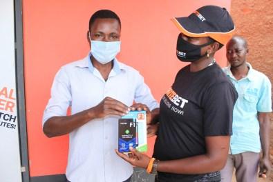 He (L) won a phone at Kiryandongo branch