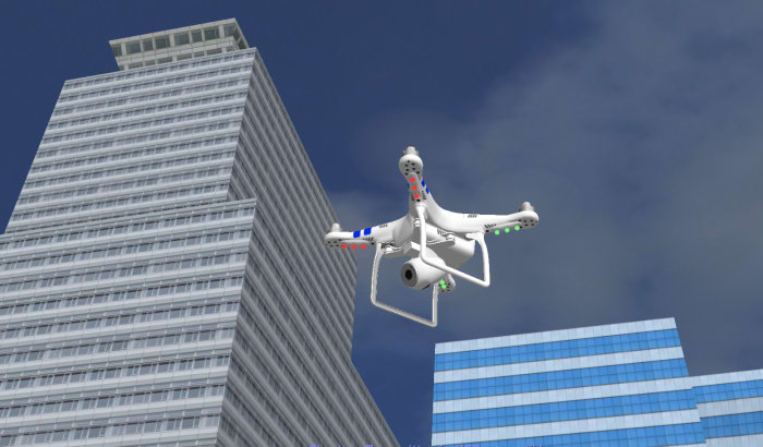 A Phantom drone flys between the buildings in the city