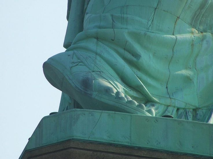The raised foot of the Statue of Liberty